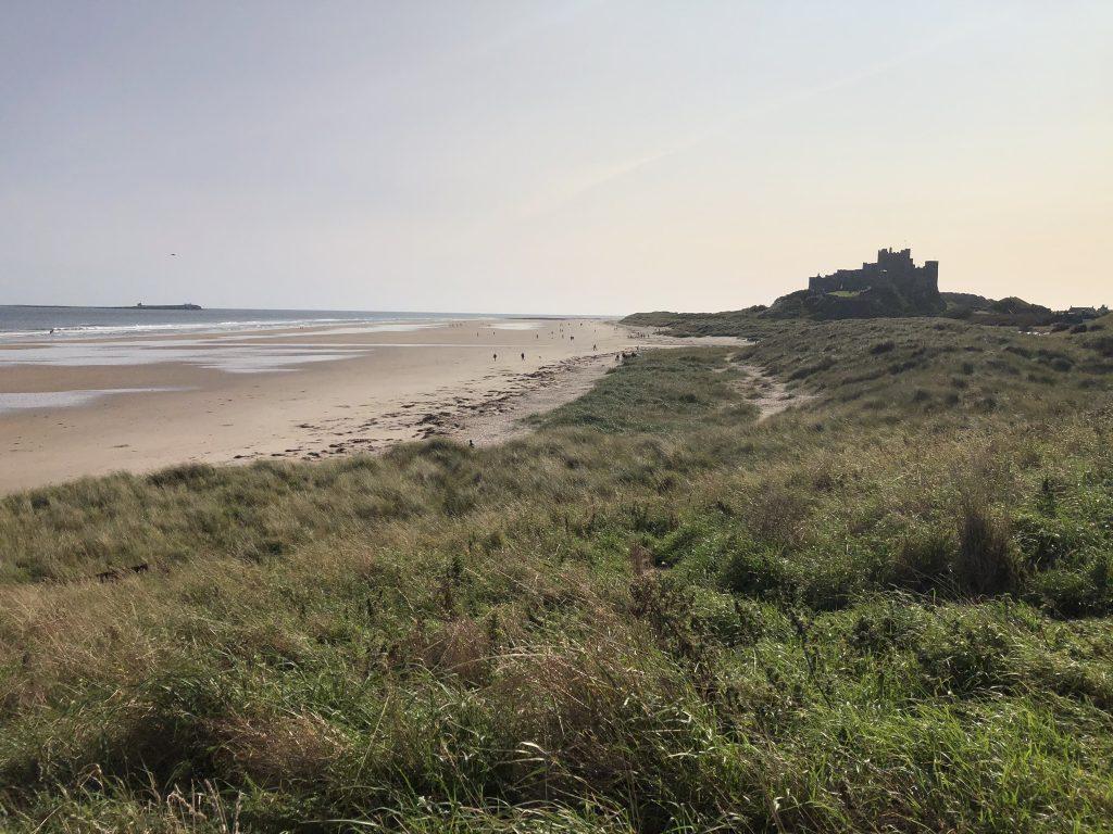 bamburgh castle overlooking the beach