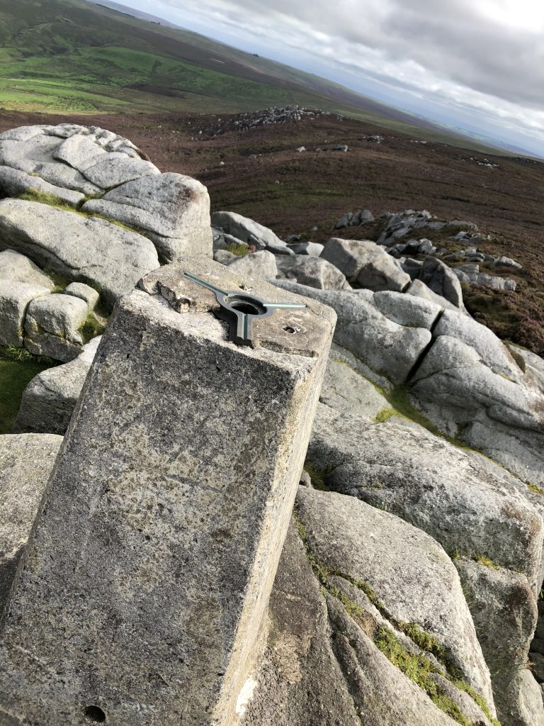 Views of the trig point on Simons Seat