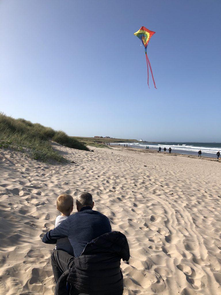 flying kites on bamburgh beach